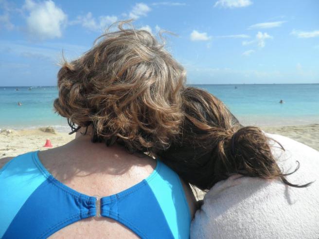 Mother daughter look at ocean
